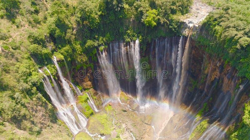 Waterfall Coban Sewu Java Indonesia. Beautiful waterfall Coban Sewu in tropical forest, Java Indonesia. aerial view tumpak sewu waterfall in rainforest stock photo