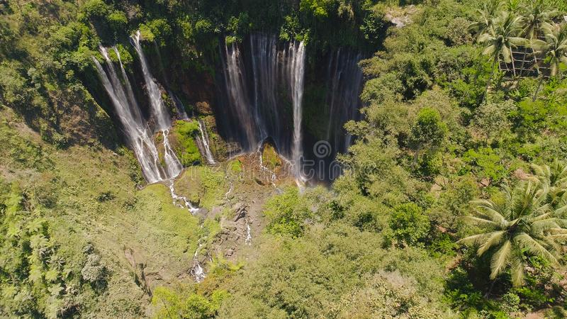 Waterfall Coban Sewu Java Indonesia. Beautiful waterfall Coban Sewu in tropical forest, Java Indonesia. aerial view tumpak sewu waterfall in rainforest royalty free stock image