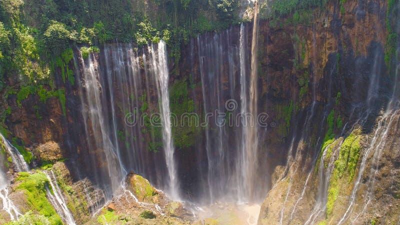Waterfall Coban Sewu Java Indonesia. Beautiful waterfall Coban Sewu in tropical forest, Java Indonesia. aerial view tumpak sewu waterfall in rainforest stock images