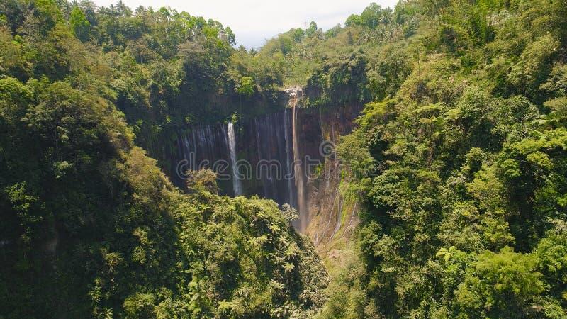 Waterfall Coban Sewu Java Indonesia. Beautiful waterfall Coban Sewu in tropical forest, Java Indonesia. aerial view tumpak sewu waterfall in rainforest royalty free stock images