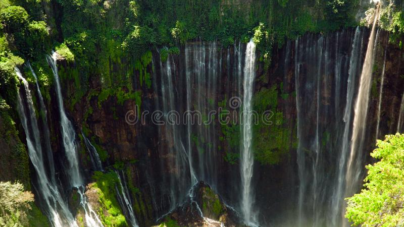 Waterfall Coban Sewu Java Indonesia. Waterfall Coban Sewu in tropical forest, Java Indonesia. tumpak sewu waterfall in rainforest aerial footage stock photography