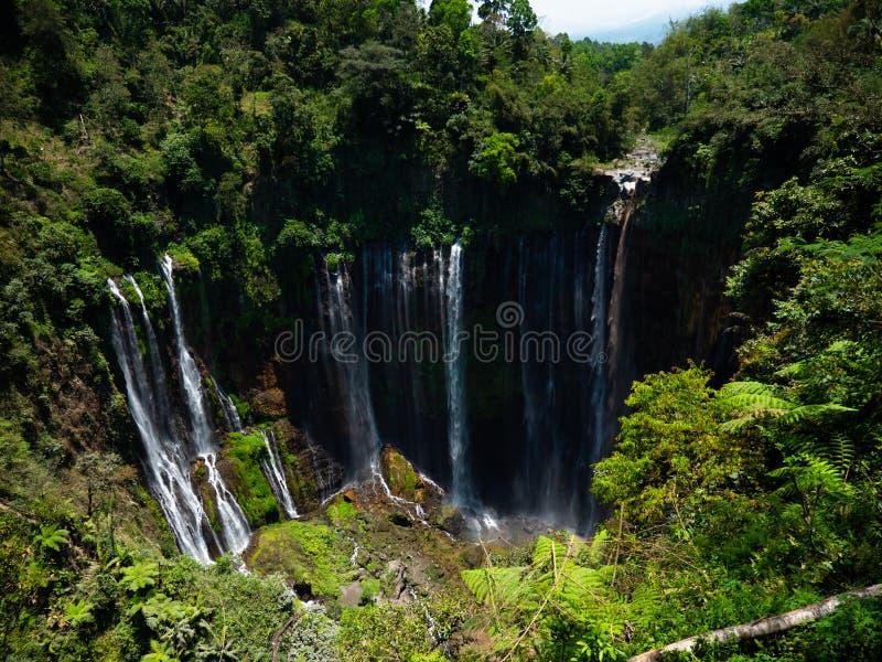 Waterfall Coban Sewu Java Indonesia. Waterfall coban sewu in Java, indonesia. waterfall in tropical forest by drone Tumpak Sewu stock images