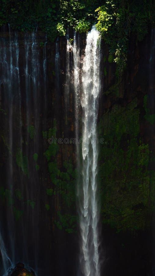Waterfall Coban Sewu Java Indonesia. Waterfall coban sewu in Java, indonesia. waterfall in tropical forest by drone Tumpak Sewu royalty free stock image