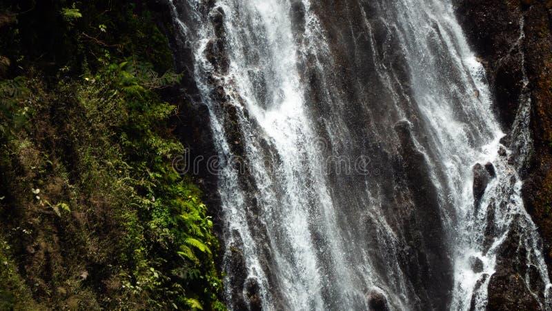 Waterfall Coban Sewu Java Indonesia. Waterfall coban sewu in Java, indonesia. waterfall in tropical forest by drone Tumpak Sewu stock image