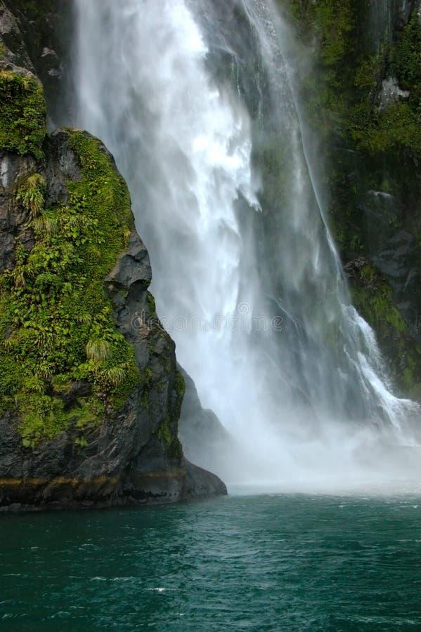 Waterfall crashing into ocean royalty free stock photo