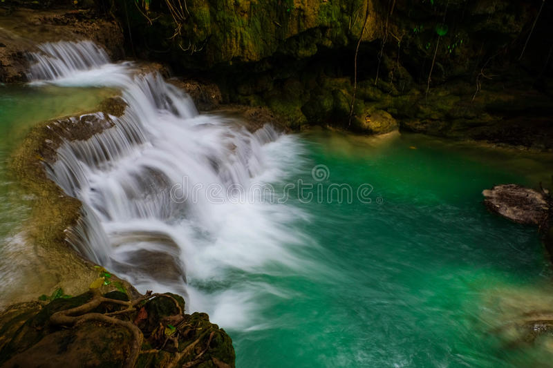 Waterfall. Creek or stream water flowing past rocks and stones royalty free stock images