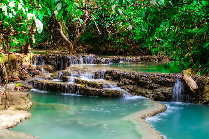 Waterfall. Creek or stream water flowing past rocks and stones stock image