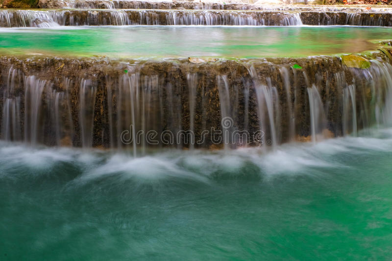 Waterfall. Creek or stream water flowing past rocks and stones royalty free stock image