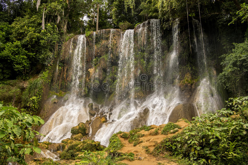 Waterfall in Cuba. Waterfall over green cliff in Cuba on summer day stock images