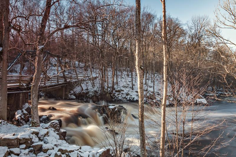 Waterfall by dam in forest. Waterfall in the forest by a dam. Klippan, Sweden stock image