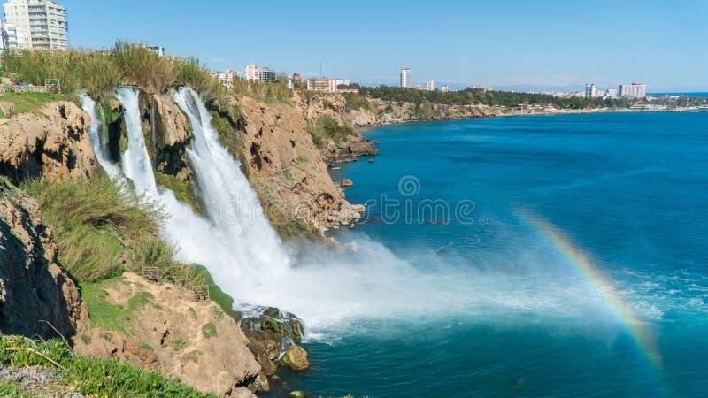 Waterfall Duden falling into the Mediterranean sea with rainbow scene, Antalya, Turkey royalty free stock photography