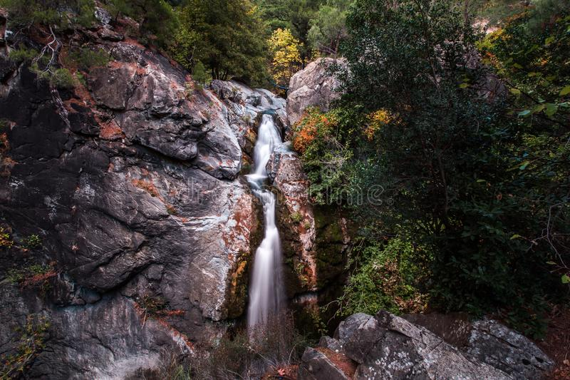 Waterfall in forest in Canakkale, Turkey. Waterfall over rocky ridge in green forest in Canakkale, Turkey on sunny day stock images