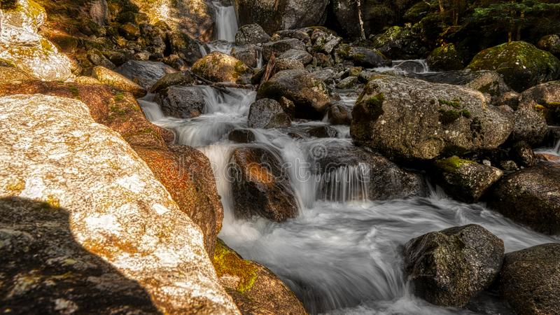 Waterfall in the forest, long time exposure stock photos