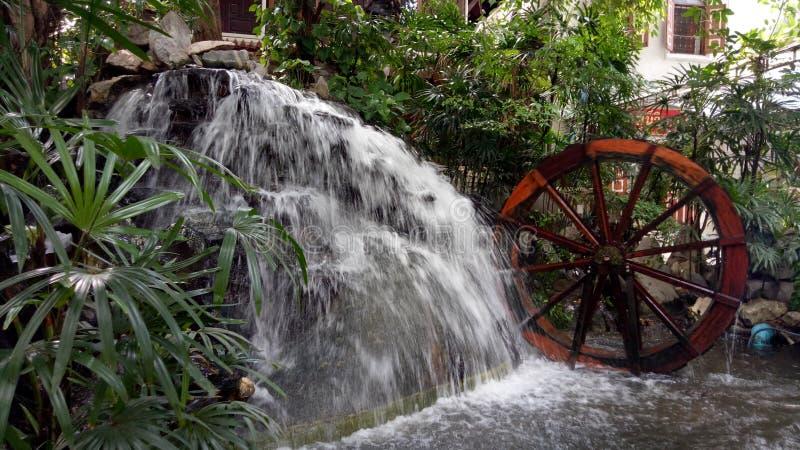 Waterfall in garden stock images