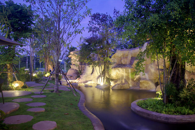 Waterfall in the garden at night stock photography