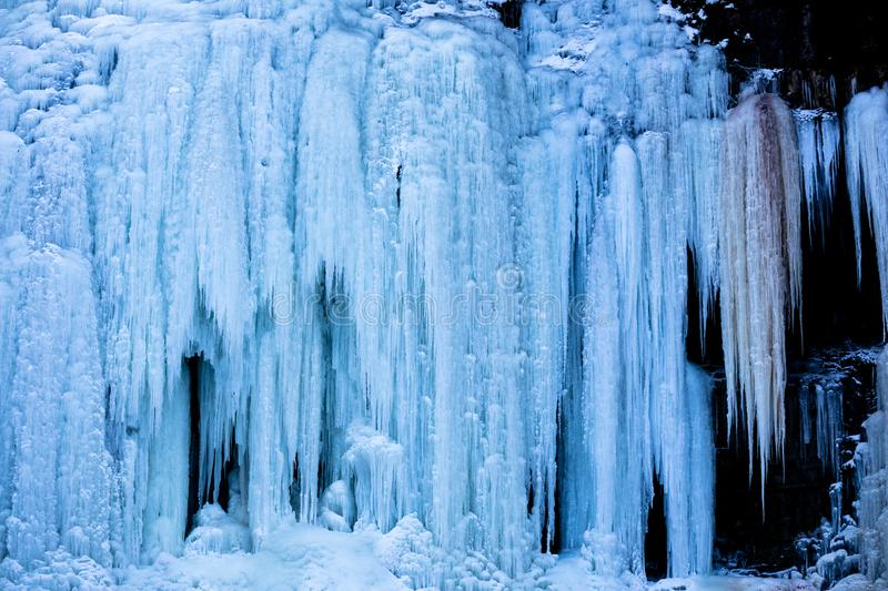 Waterfall in the Extreme Cold. A waterfall in Hamilton Ontario Canada that froze solid during a polar vortex in winter royalty free stock images
