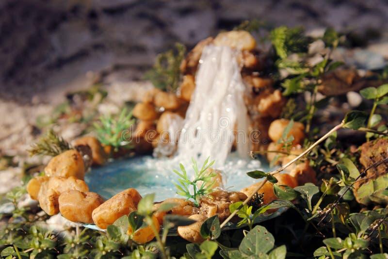 Waterfall hand made. Blurred background | macro shot sharp image| smart click royalty free stock photo