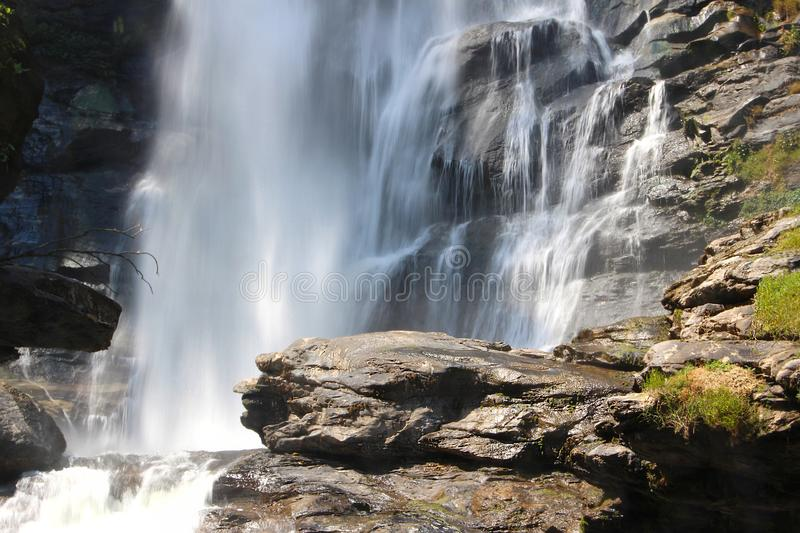 Waterfall hidden in the tropical jungle. In thailand royalty free stock image