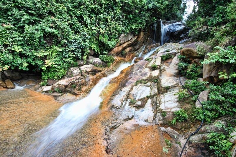 Waterfall at highway Kuala Berang to Gua Musang. In the middle of highway at Hulu Terengganu, Terengganu, Malaysia royalty free stock photo