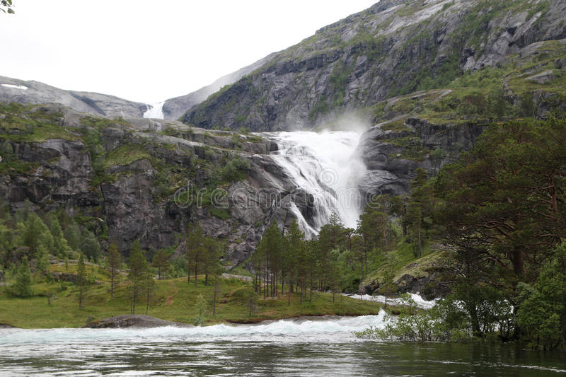 Waterfall in Husedalen valley in Hardangervidda national park, Norway stock image