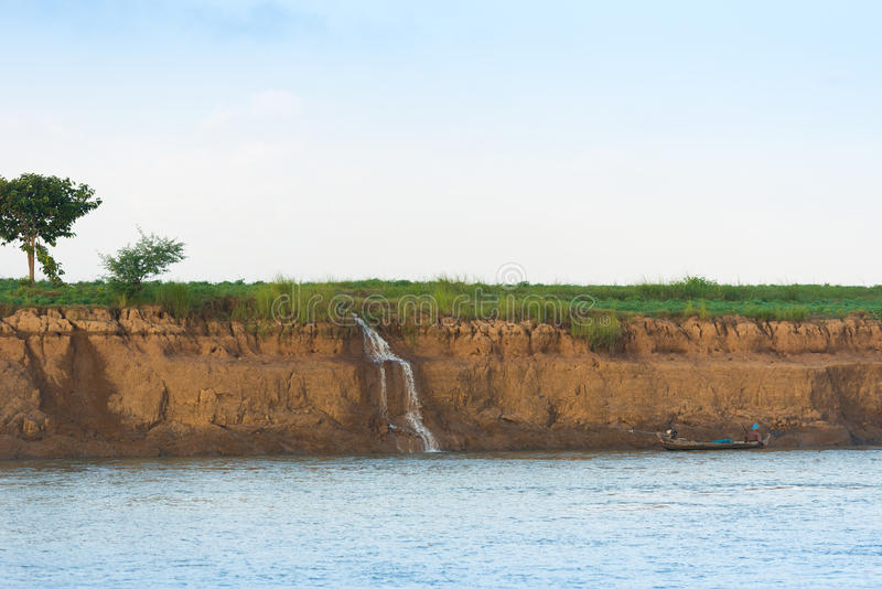 Waterfall on the Irrawaddy river, Mandalay, Myanmar, Burma. Copy space for text. royalty free stock images