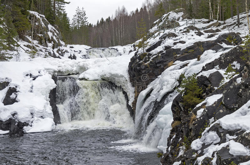 Waterfall Kivach in winter. Karelia, Russia. Waterfall Kivach Karelia, Russia. View from below. Early March, the extremely low water levels royalty free stock photography
