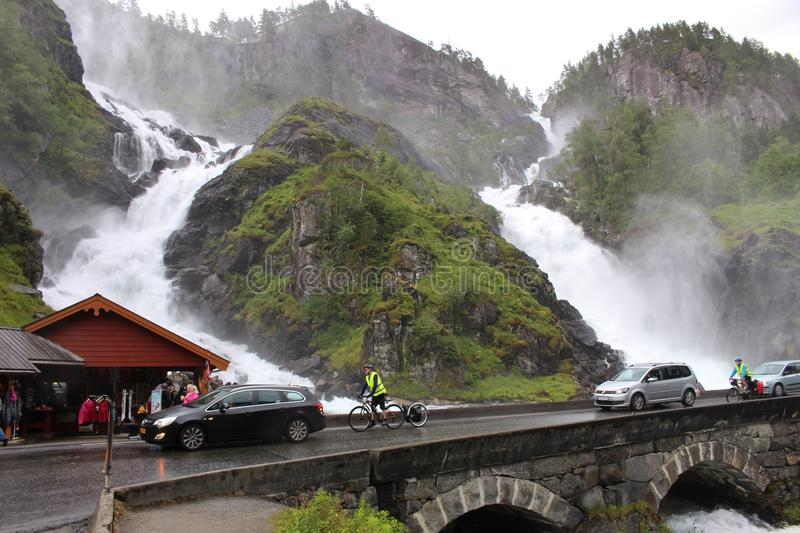 The waterfall Langfoss in Norway, Scandinavia, Europe. ODDA, NORWAY – AUGUST 1, 2015: The waterfall Langfoss in Norway, not far from the town Odda. It stock photo