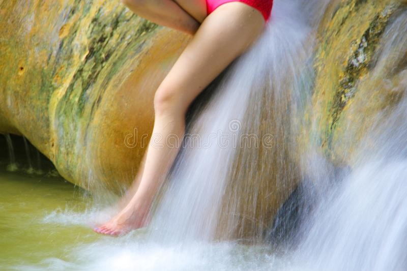 Waterfall and leg of woman enjoy in the water.  stock images