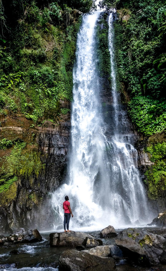 Waterfall and man in perspective stock image