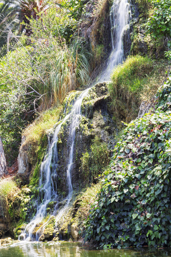 Waterfall in the meditation Garden in Santa Monica, United States. Park of five religions at the lake Shrine, landscape stock photo