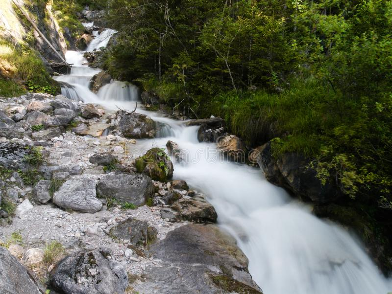 Waterfall in the middle of a forest stock image