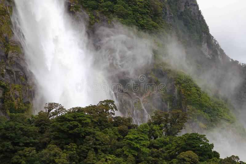 Waterfall in Milford sound, New Zealand royalty free stock photos