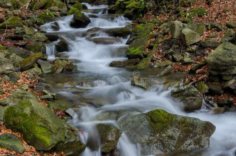 Waterfall with mossy rocks stock photo