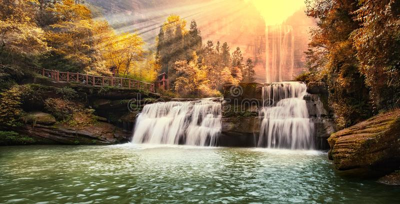 Waterfall in mountains at Chongqing. Beautiful high waterfalls in mountains in China`s Chongqing stock photos