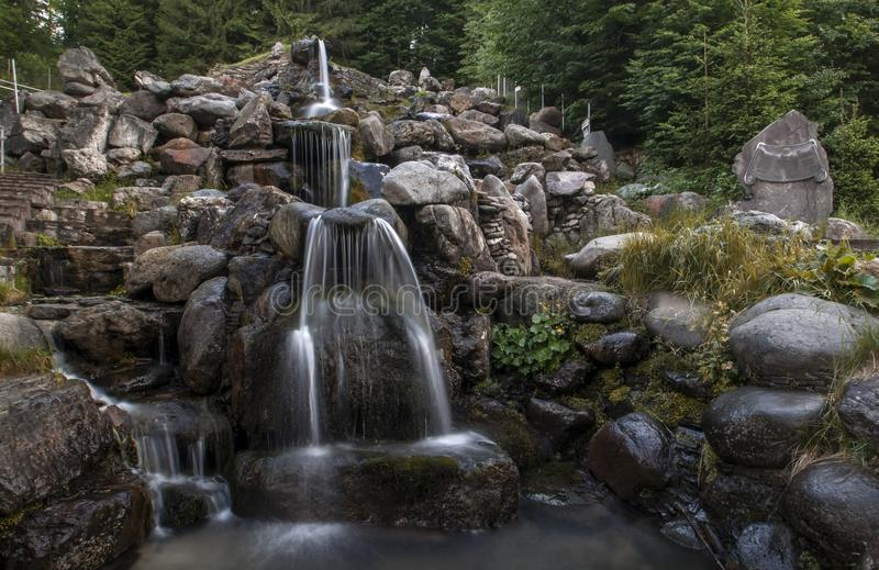 Waterfall in the mountins stock photography