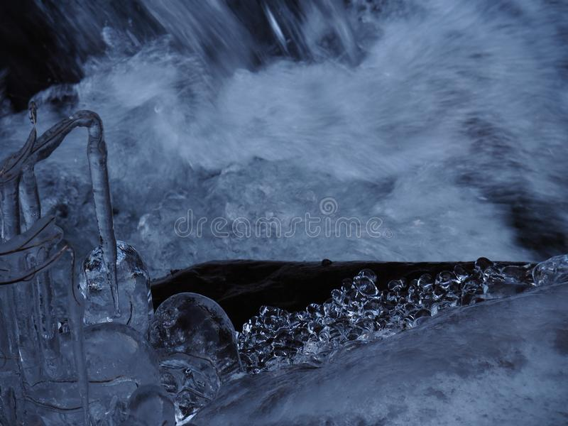 Diamonds of ice near waterfall stock images