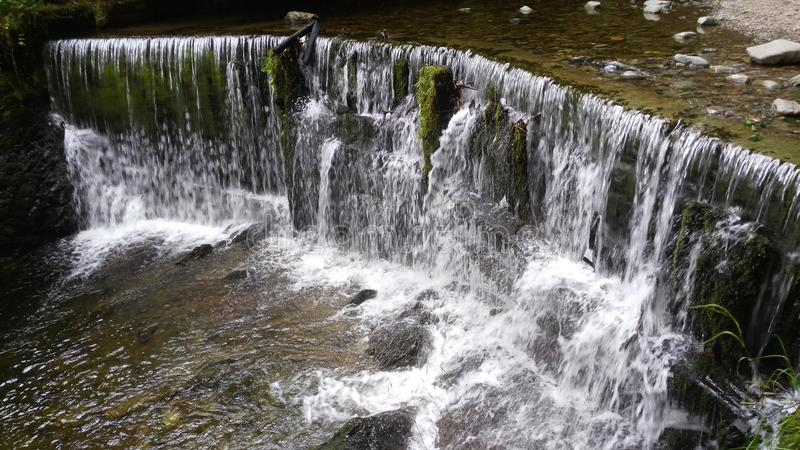 Waterfall nature with stones stock images