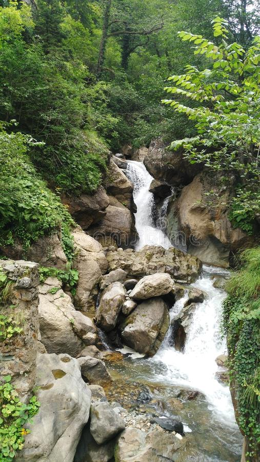 Waterfall, Nature. Waterfall surrounded by green trees stock images