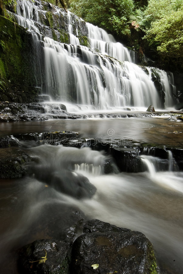 Waterfall in New Zealand. Purakaunui Falls, Catlins South Island New Zealand. Long exposure - silky smooth water. Peace nature and tranquility stock images