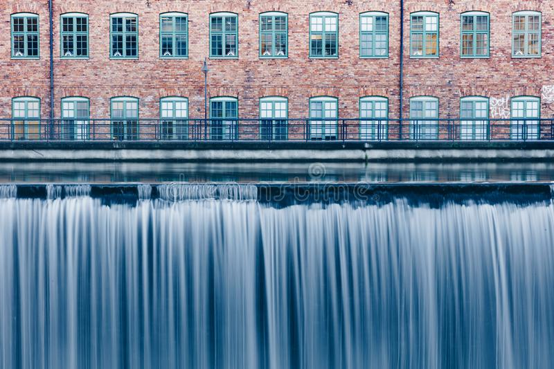 Waterfall in the old industrial area in Norrkoping, Sweden stock image