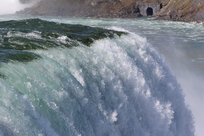 Waterfall and opposing shoreline. Waterfall with mist and opposing shoreline stock images
