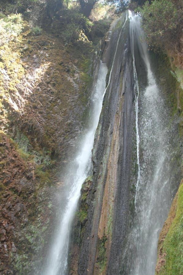 Waterfall over cliff in Chinchero, Peru.  stock photos