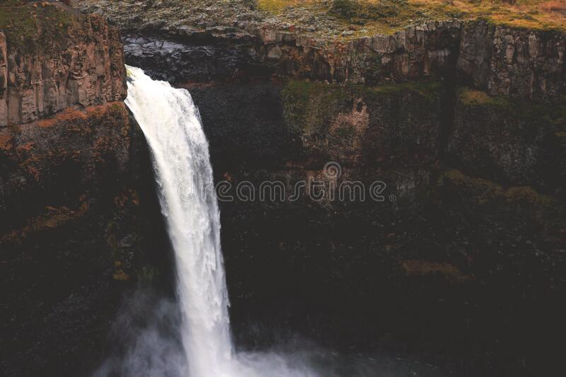 Waterfall over Cliff stock images