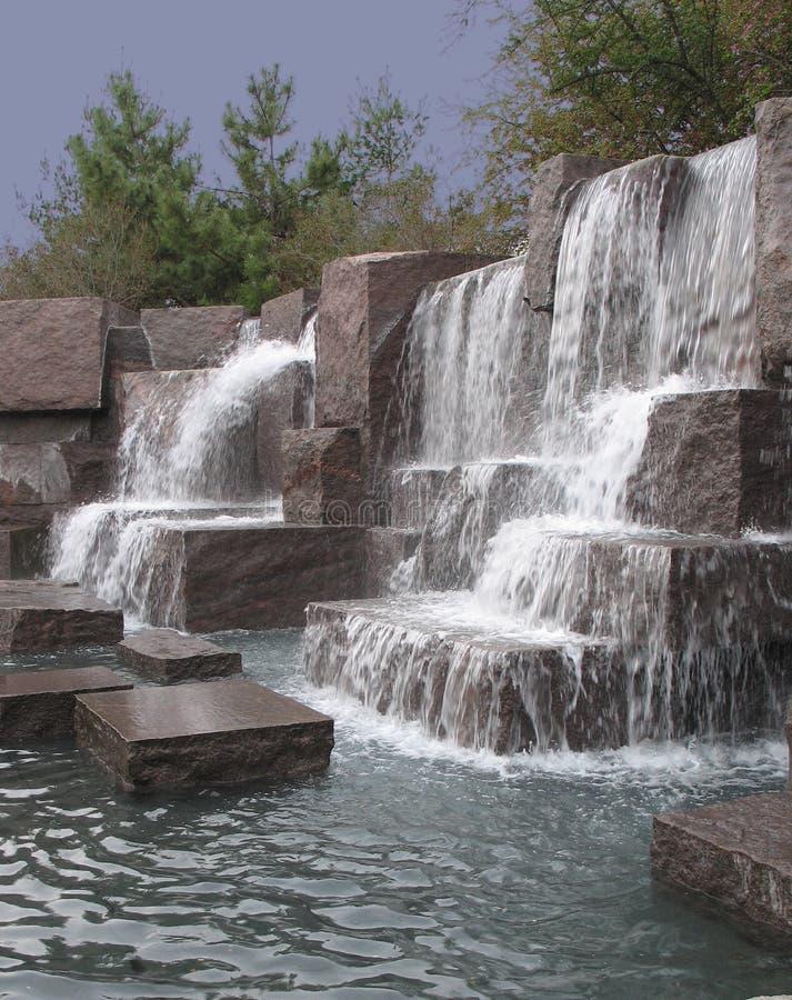 Waterfall over granite blocks royalty free stock photos
