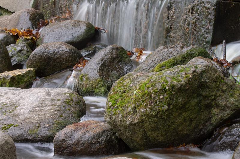 Waterfall over granite rocks fast water flow. Beautiful waterfall landscape on granite stones. fast water flow with blur effect royalty free stock images