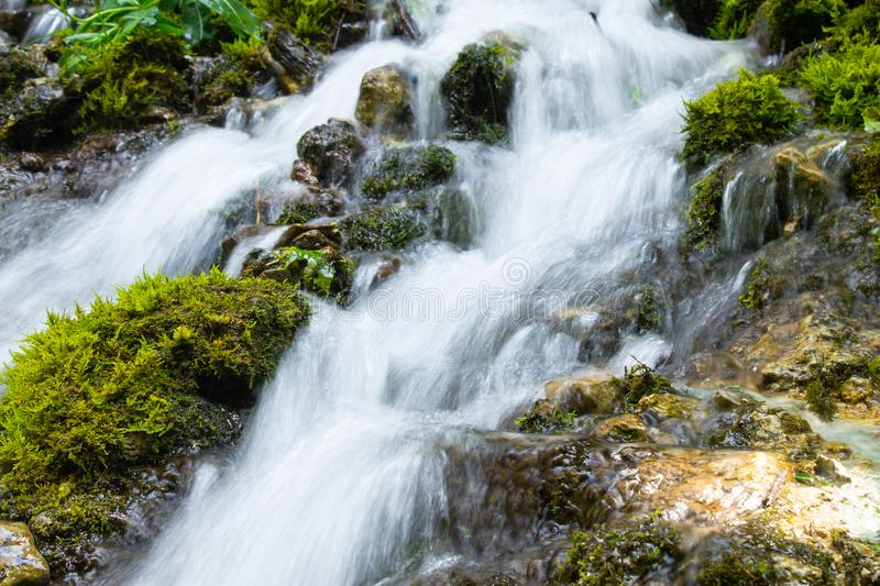 Waterfall over granite rocks fast water flow. Beautiful waterfall landscape on granite stones. fast water flow with blur effect stock photos