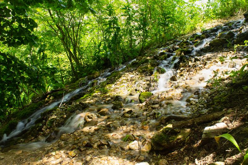 Waterfall over granite rocks fast water flow. Beautiful waterfall landscape on granite stones. fast water flow with blur effect stock images