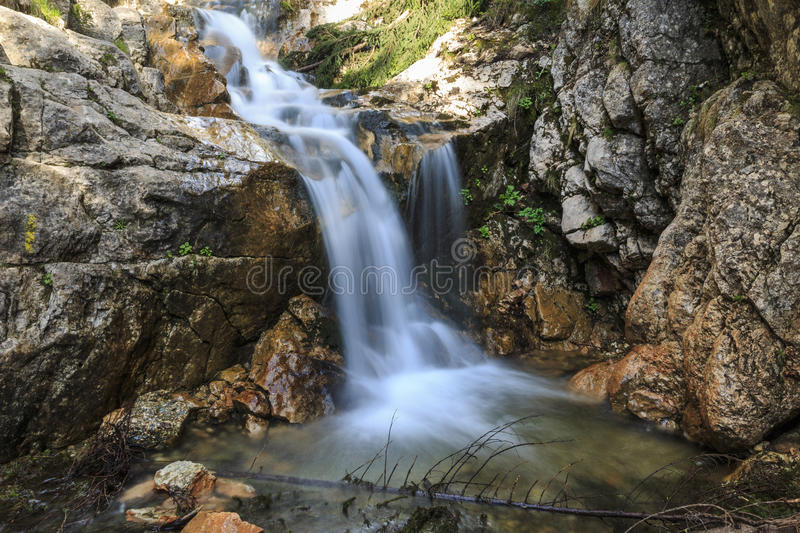 Waterfall over limestone rocks in the Carpathians stock photography
