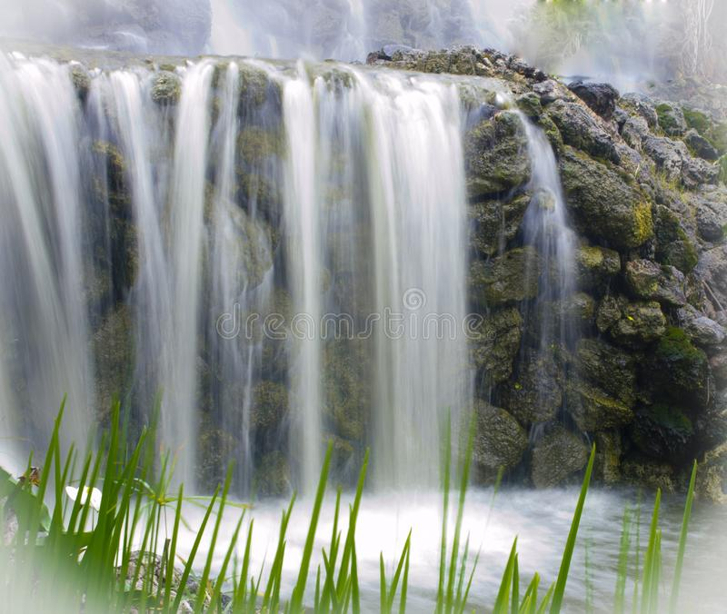 Waterfall over rocky cliff stock image