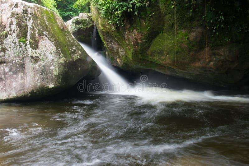 Waterfall in Parque Nacional da Serra dos Orgaos in Guapimirim,. Poco Verde waterfall in Parque Nacional da Serra dos Orgaos in Guapimirim, Rio de Janeiro royalty free stock photos